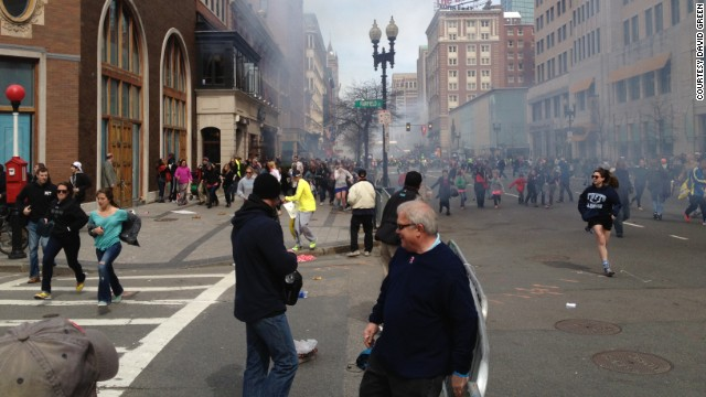 FBI Suspect No. 2, later said to be Dzhokhar Tsarnaev, is apparently seen in this picture, far left in white cap, from Boston Marathon runner David Green at the scene of the bombings on Monday, April 15.