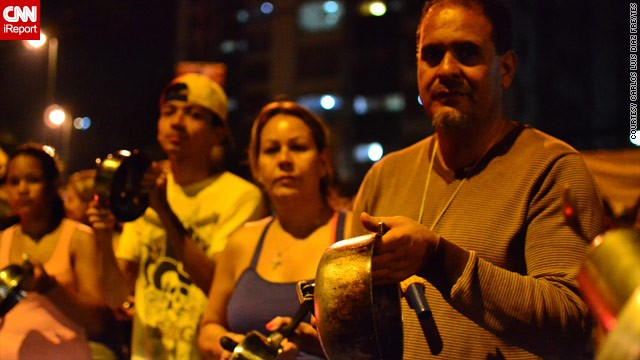 "Opposition supporters in iReporter <a href='http://ireport.cnn.com/docs/DOC-957905'>Carlos Luis Diaz Freytes'</a> Caracas neighborhood took part in a ""cacerolazo"" -- literally ""casserole"" -- protest on Monday night."