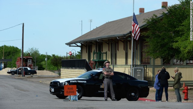 A Texas State Trooper stops people from entering a neighborhood near the plant on April 18.