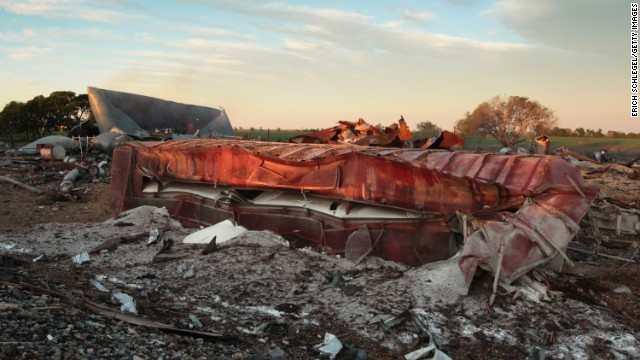 A railroad boxcar lies on its side near the plant on April 18.