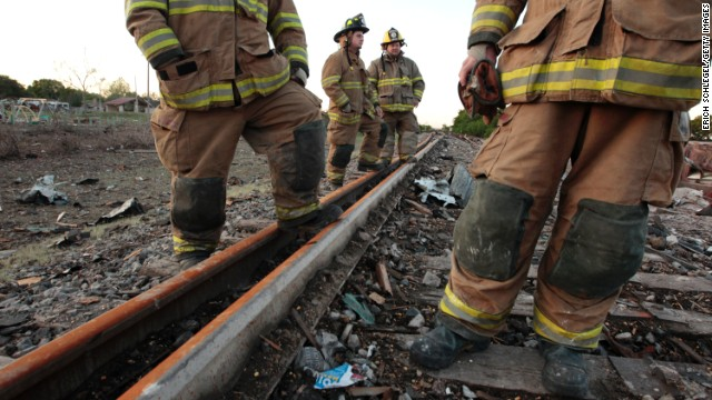 Valley Mills Fire Department personnel view the railroad tracks near the fertilizer plant on April 18.