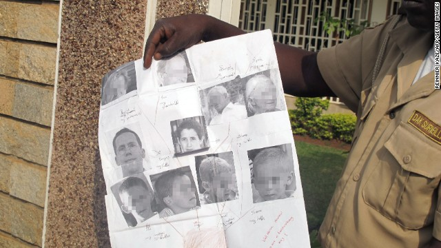 February 21, 2013: Security guard shows photos of the French family kidnapped on February 19.