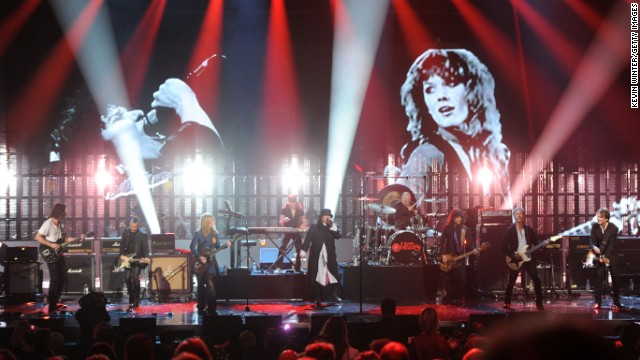 Chris Cornell and Mike McCready of Pearl Jam perform alongside Heart.