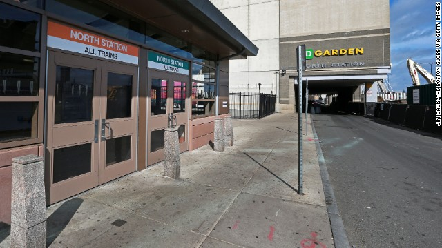 The area around the North Station next to the TD Garden is deserted April 19 with public transportation shut down in the Boston area.
