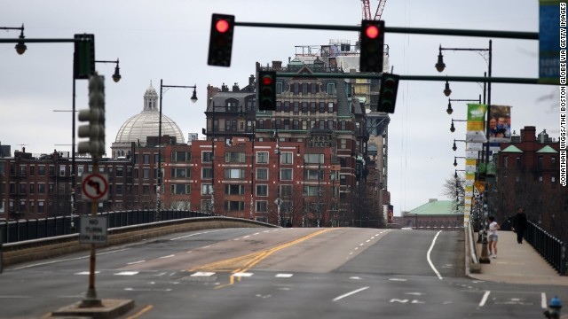 Only a few pedestrians cross the Harvard Bridge, known locally as the Massachusetts Avenue Bridge, on April 19.