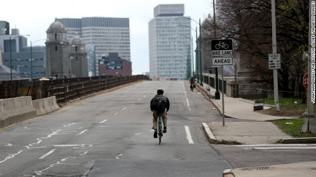 A lone bicyclist makes his way across the Longfellow Bridge to Boston from Cambridge on April 19.