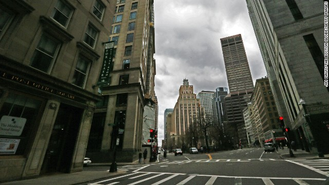 Congress Street in Boston appears mostly empty on April 19, looking toward Post Office Square.