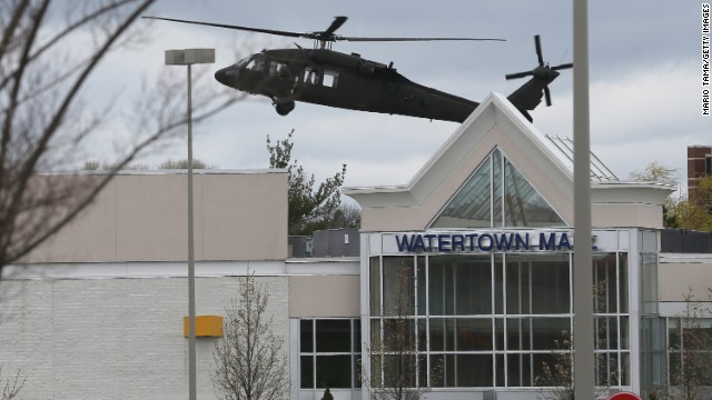 A U.S. military helicopter lands behind Watertown Mall as law enforcement agencies continue to search for the 19-year-old bombing suspect on Friday.