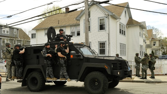 SWAT teams continue to search for the man identified by the FBI as Dzhokhar Tsarnaev on Friday, April 19, in Watertown, Massachusetts. The lockdown for the Boston area is lifted at 6 p.m., meaning people can again leave their homes, even though a suspect remains at large.