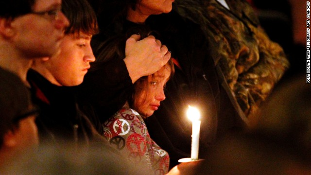 A young mourner is comforted during the vigil on April 18.