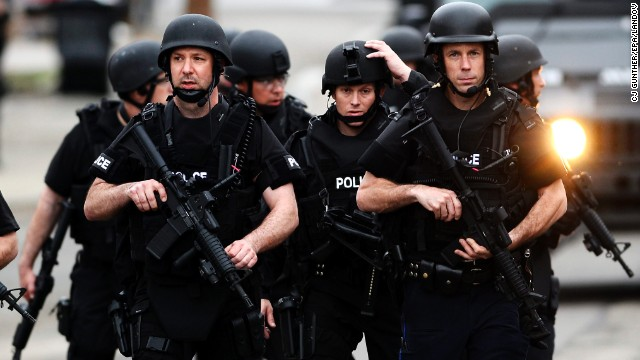 SWAT team members move down residential streets as they perform door-to-door searches in Watertown, Massachusetts, on April 19.