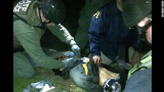 An image posted to the social sharing website Reddit purports to show suspect Dzhokhar Tsarnaev being detained by law enforcement officers.
