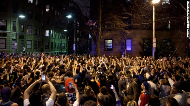 Around 200 people celebrate on Hemingway Street in the Fenway neighborhood after the capture of the second suspect on April 19.