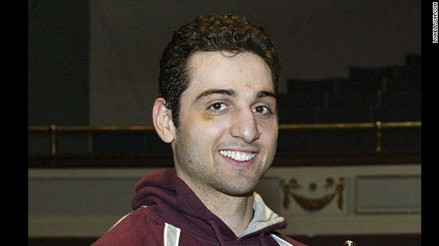 Police say the dead suspect, <a href='http://www.cnn.com/2013/04/21/us/tamerlan-tsarnaev-timeline/index.html'>Tamerlan Tsarnaev</a>, is the man the FBI identified as Suspect 1. He was killed during the shootout with police in Watertown, Massachusetts, on April 19, 2013. He is pictured here at the 2010 New England Golden Gloves.