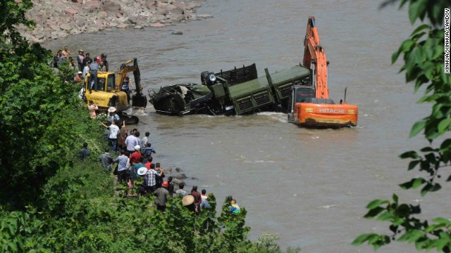 A rescue car from Chengdu Military Region falls off a cliff into a river in Sichuan Province. Two of the 17 soldiers in the car had died by 11:30 p.m. Saturday Beijing time.