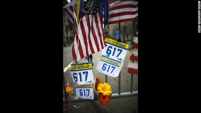 Items hang from a barrier Saturday at the makeshift memorial near the site of the Boston Marathon bombings.