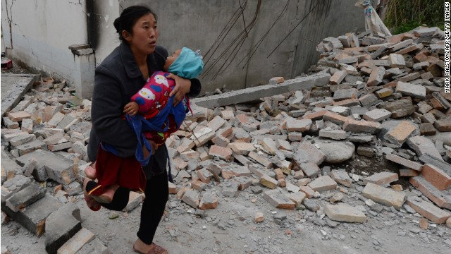In China, rescuers race to find survivors from quake that killed scores