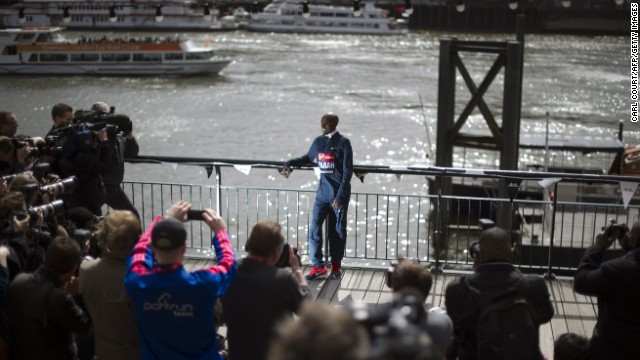 British Olympic double gold medalist Mo Farah poses for photographers in central London on April 18, 2013 during a photo call ahead of the London marathon. The London Marathon will go ahead as planned on April 21, 2013 after security arrangements were reviewed in the wake of the bombings that caused carnage at the Boston Marathon, organizers and police said.