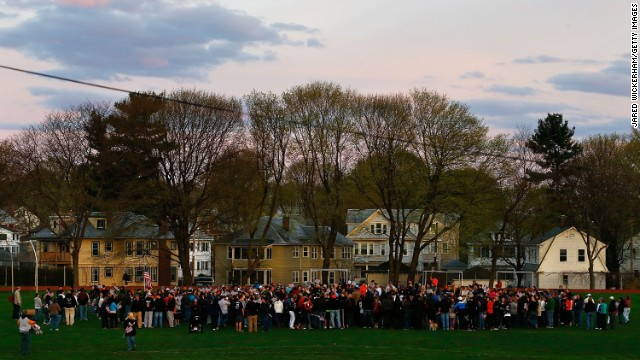 Watertown residents gather to attend a candlelight vigil at Victory Park on April 20.