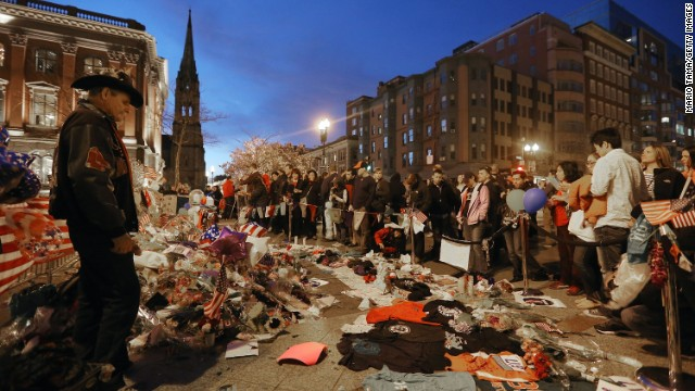 People gather at a makeshift memorial for victims on April 20.