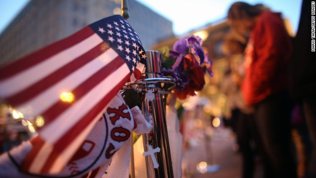 A flag decorates the memorial on Boylston Street in Boston on April 20.