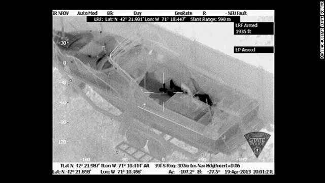 Helicopters with infrared devices detect a man under the boat tarp. Dzhokhar Tsarnaev's frame is seen in this <a href='http://www.cnn.com/2013/04/17/us/gallery/boston-evidence/index.html'>thermal image released by Massachusetts State Police.</a>
