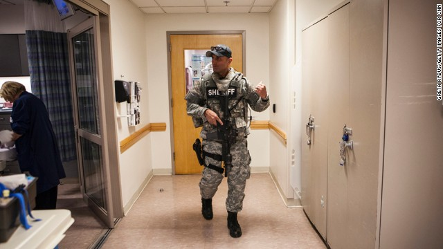 Security was heightened at the Tufts Medical Center, with SWAT teams roaming hallways.