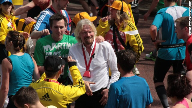 Virgin Group founder Richard Branson was at the finish line to greet runners as they finished the 26.2-mile race.