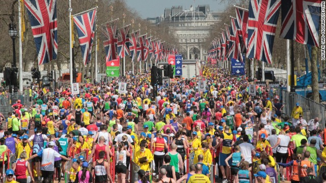 Exhausted participants flood the Mall in central London after finishing the London Marathon on April 21, 2013.