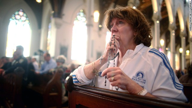 Nurse practitioner Maureen Quaranto, who treated victims of the Boston Marathon bombings, wears her Boston Marathon jacket during Mass at the Cathedral of the Holy Cross on Sunday, April 21, in Boston.