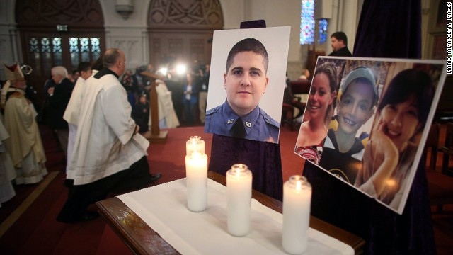 Photos of the deceased are displayed at the Cathedral of the Holy Cross on April 21, the first Sunday since the Boston Marathon bombings.