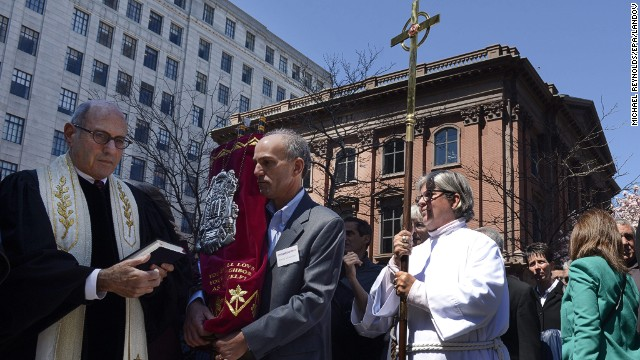 Leaders of an interfaith service participated in a vigil at the memorial for the victims of the Boston Marathon bombings, near the finish line on Boylston Street in Boston on April 21.