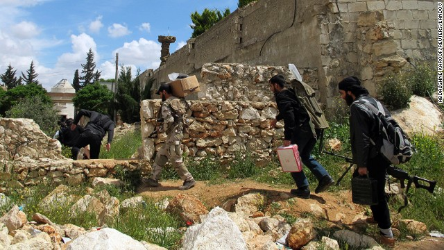 Free Syrian Army fighters take positions prior to an offensive against government forces in the Khan al-Assal area, near Aleppo on Saturday, April 20.