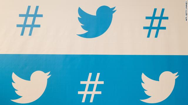 Twitter says it's adding staff to handle complaints as well as a report-abuse button.