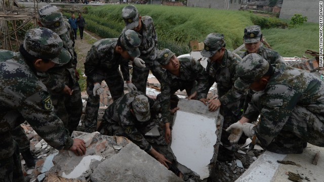 Chinese soldiers search for survivors on Sunday, April 21, in Lushan County.