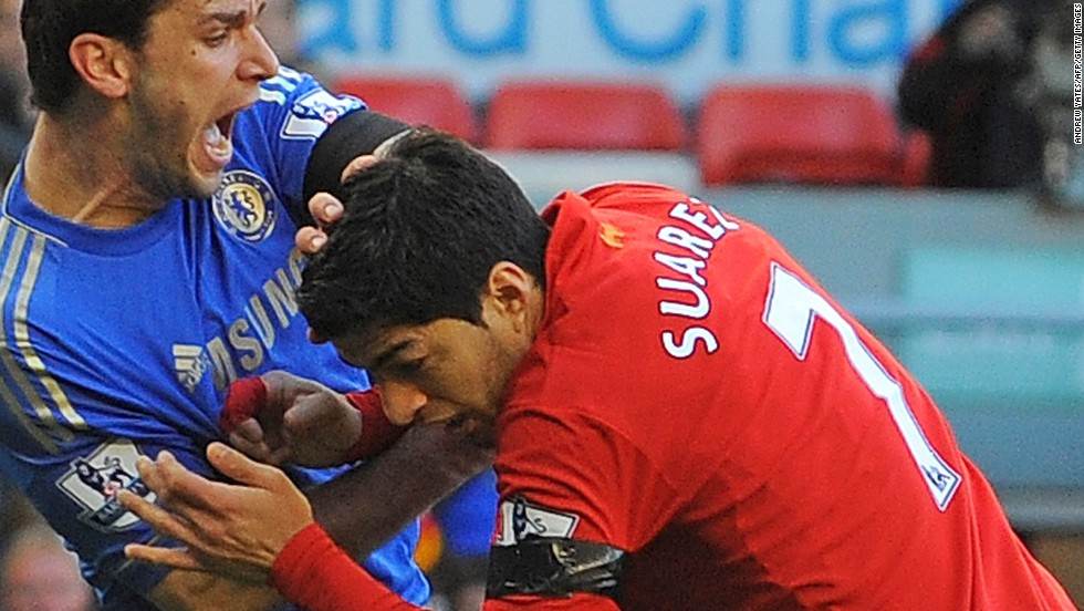"Liverpool's <a href='http://www1.skysports.com/watch/video/sports/football/8663783/suarez-biting-incident' target='_blank'>Luis Suarez has been banned for 10 games by the English Football Association for biting Chelsea's Branislav Ivanovic</a> during Sunday's match at Anfield. It was the latest example of a player displaying questionable behavior in front of a vast array of television cameras. As football coverage has grown over the last two decades, so has the scrutiny placed on the stars of the ""beautiful game."" In this gallery, CNN highlights times when players have seemingly forgotten the eyes of the world are watching..."