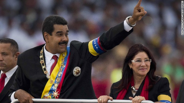 Venezuelan President Nicolas Maduro waves to the crowd during a motorcade after his installation in Caracas on April 19.