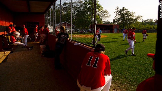 The Cairo High School baseball team waits between innings during a game against Americus-Sumter High School. The field at the school is named after Robinson.