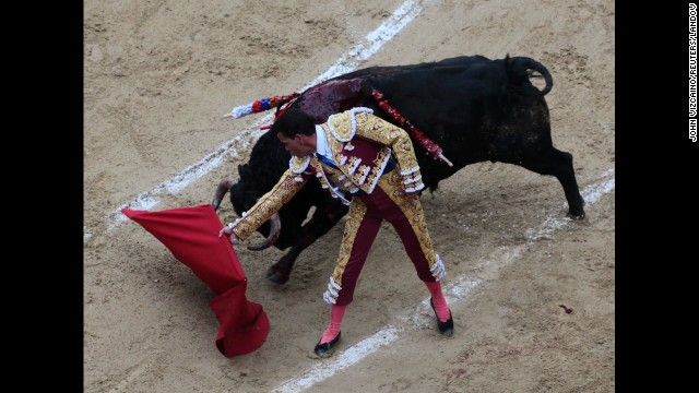 Colombian bullfighter Sebastian Vargas performs a pass during a bullfight at La Santamaria bullring in Bogota in January 2012.