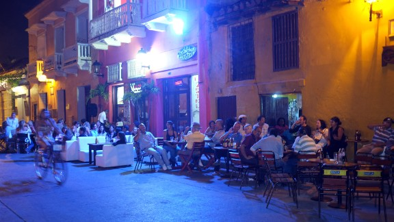 CARTAGENA of INDIAS, COLOMBIA - JANUARY 28, 2012: People sit outside restaurants and bars situated on the corner of a small square inside the city walls on January 28, 2012 in Cartagena, Colombia. (Photo by Kaveh Kazemi/Getty Images)