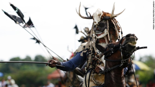 A costumed performer takes part in a traditional folk festival in San Martin in the province of Meta in November 2012.