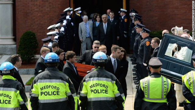 Pallbearers carry the casket of victim Krystle Campbell from St. Joseph Catholic Church after a funeral service on April 22 in Medford, Massachusetts.