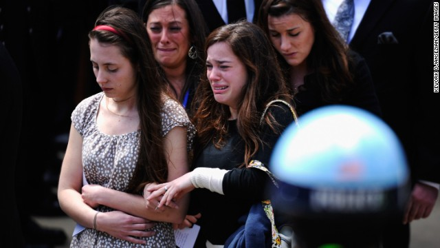 Mourners walk out of St. Joseph Catholic Church after Krystle Campbell's funeral service.