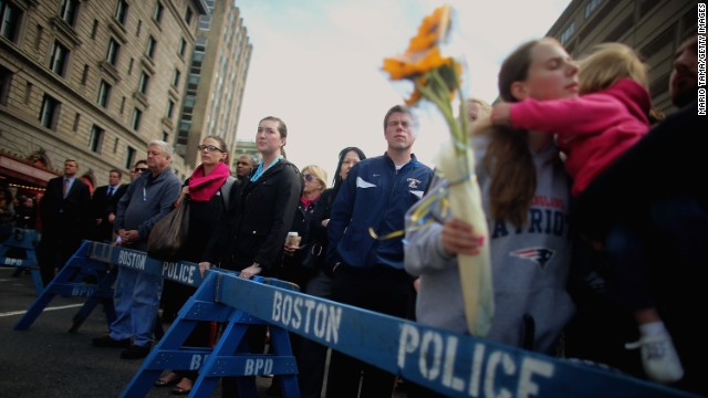 One week after the Boston Marathon bombings, people gather to observe a moment of silence in the city's Copley Square on April 22.