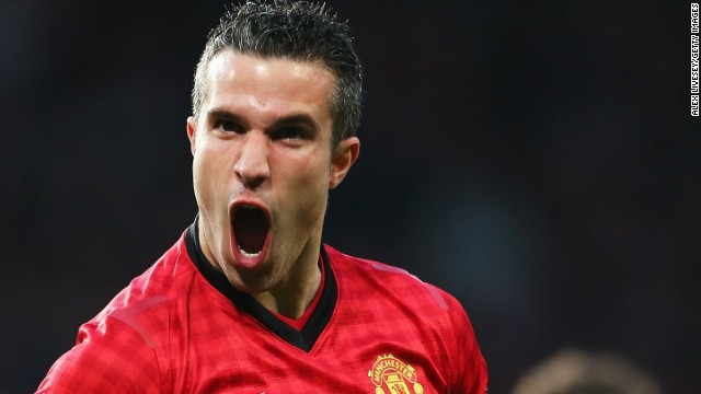 Manchester United striker Robin van Persie celebrates after scoring the opening goal the 3-0 win over Aston Villa as the Red Devils secured the English Premier League title.