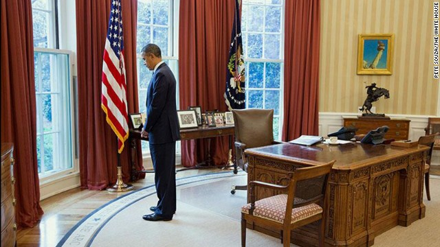 President Barack Obama observes a moment of silence in honor of the victims of the Boston Marathon bombings, in the Oval Office in Washington on Monday, April 22. Massachusetts Gov. Deval Patrick asked his state and beyond to honor the victims at 2:50 p.m., the time of the first explosion.