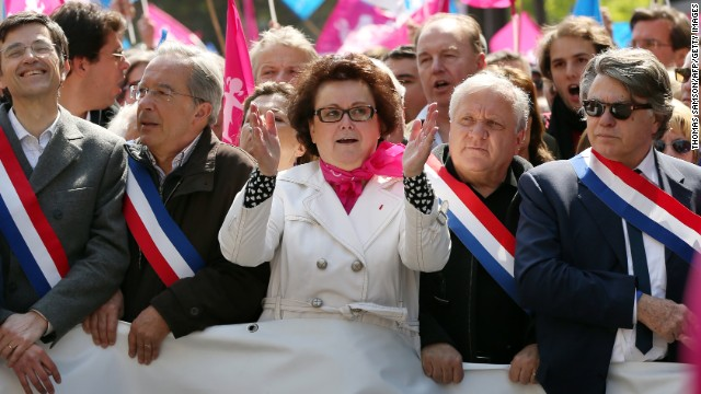 Leader of the French Christian Democratic Party, Christine Boutin, center, and MP Gilbert Collard, right, participate in an anti-gay marriage demonstration on Sunday.