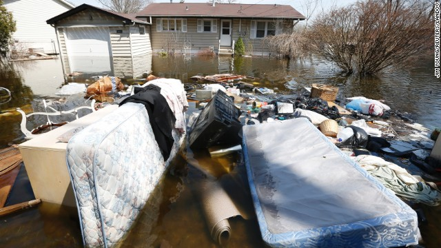 Household items are submerged in floodwaters in front of a house in Fox Lake, Illinois, on Monday, April 22. Steady rains are expected Tuesday, April 23, in several Midwestern states already facing severe flooding. Have you been affected by the flooding? &lt;a href='http://ireport.cnn.com/topics/962945' target='_blank'&gt;Share your images with CNN iReport&lt;/a&gt;.