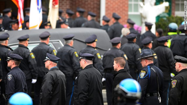 Law enforcement officials enter St. Patrick's Church in formation prior to the funeral for Massachusetts Institute of Technology Police Officer Sean Collier in Stoneham, Massachusetts, on Tuesday, April 23. Collier was allegedly shot and killed by Boston Marathon bombing suspects Dzhokhar and Tamerlan Tsarnaev on Friday, April 19.