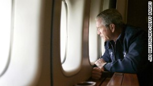 President George W. Bush surveys Katrina storm damage from Air Force One over New Orleans on August 31, 2005. The famous photo left many feeling Bush was detached from the suffering of people affected by the deadly hurricane.